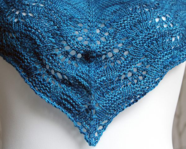 A close up the centre of the cowlette showing the rippling lace and textured border