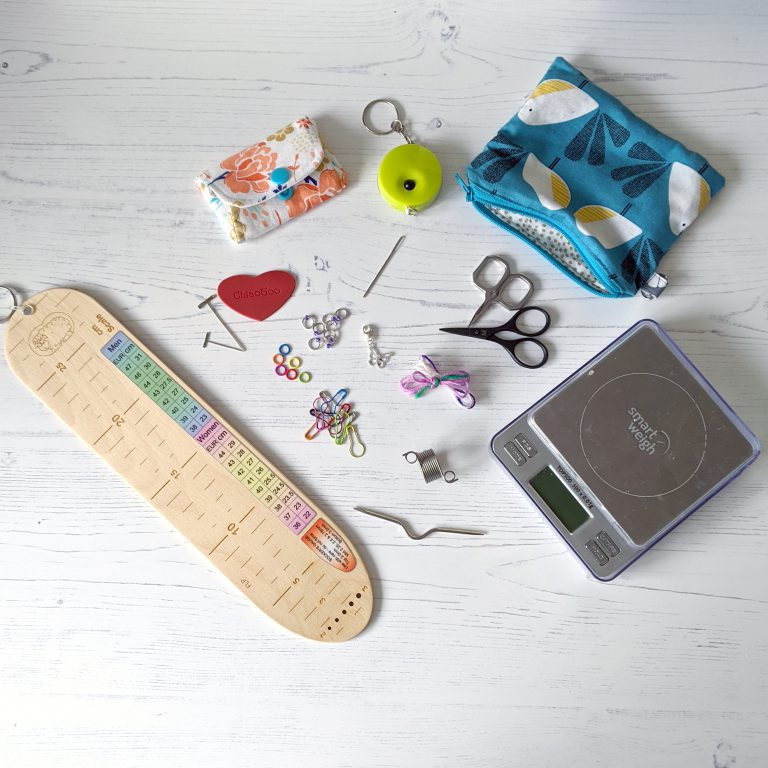 The same items as before, along with a sock ruler, cable needle, knitting thimble and scales