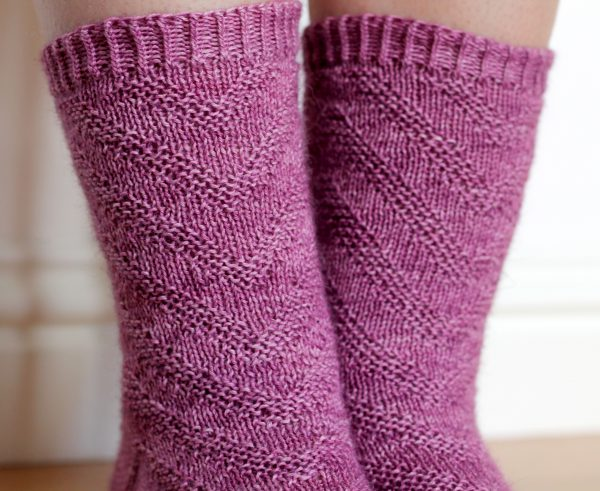 Purple socks with a textured chevron pattern repeated up the sock