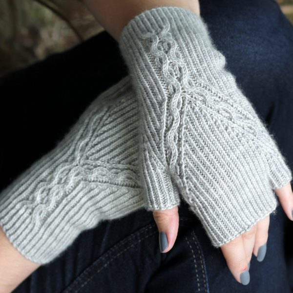 Twisted Rib fingerless mitts with a cable up the centre of the back of the wrist and splitting to either side of the hand