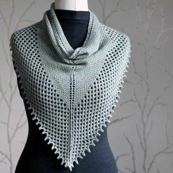 A triangular cowlette with a textured body, wide lace border and picot bind-off