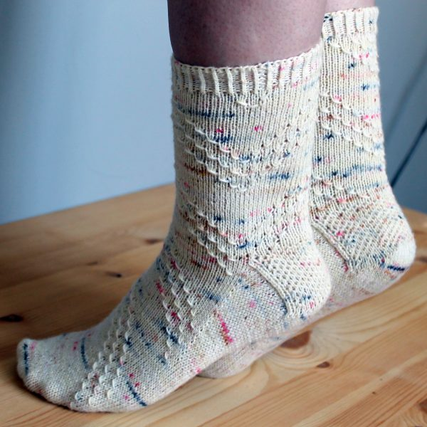 A pair of socks with a textured diagonal stripe mirrored on each foot