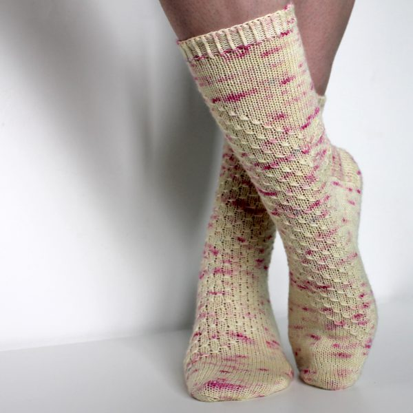 Speckled socks with a wide diagonal stripe with a textured pattern mirrored across each foot