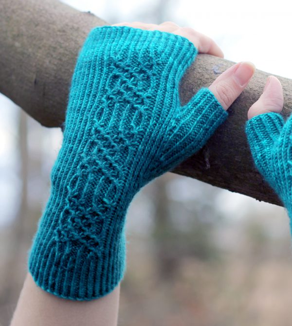 Twisted rib fingerless mitts with a smocked faux cable trellis patter asymmetrically on the back of the hand