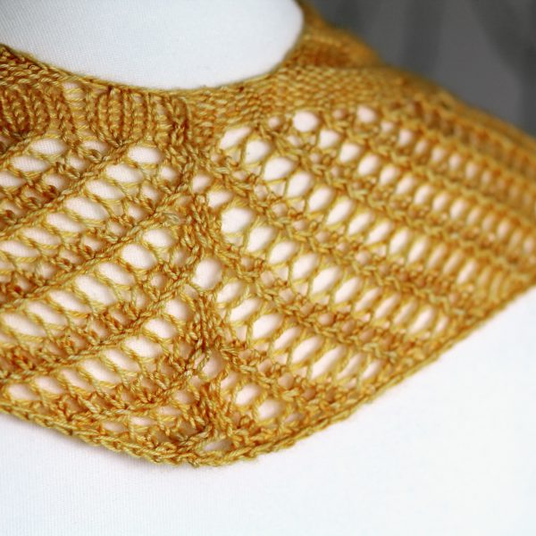 A yellow cowl with a ribbed body and wide lace border