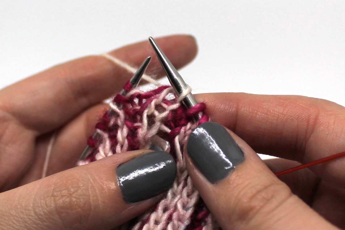 A brk stitch worked in white yarn.