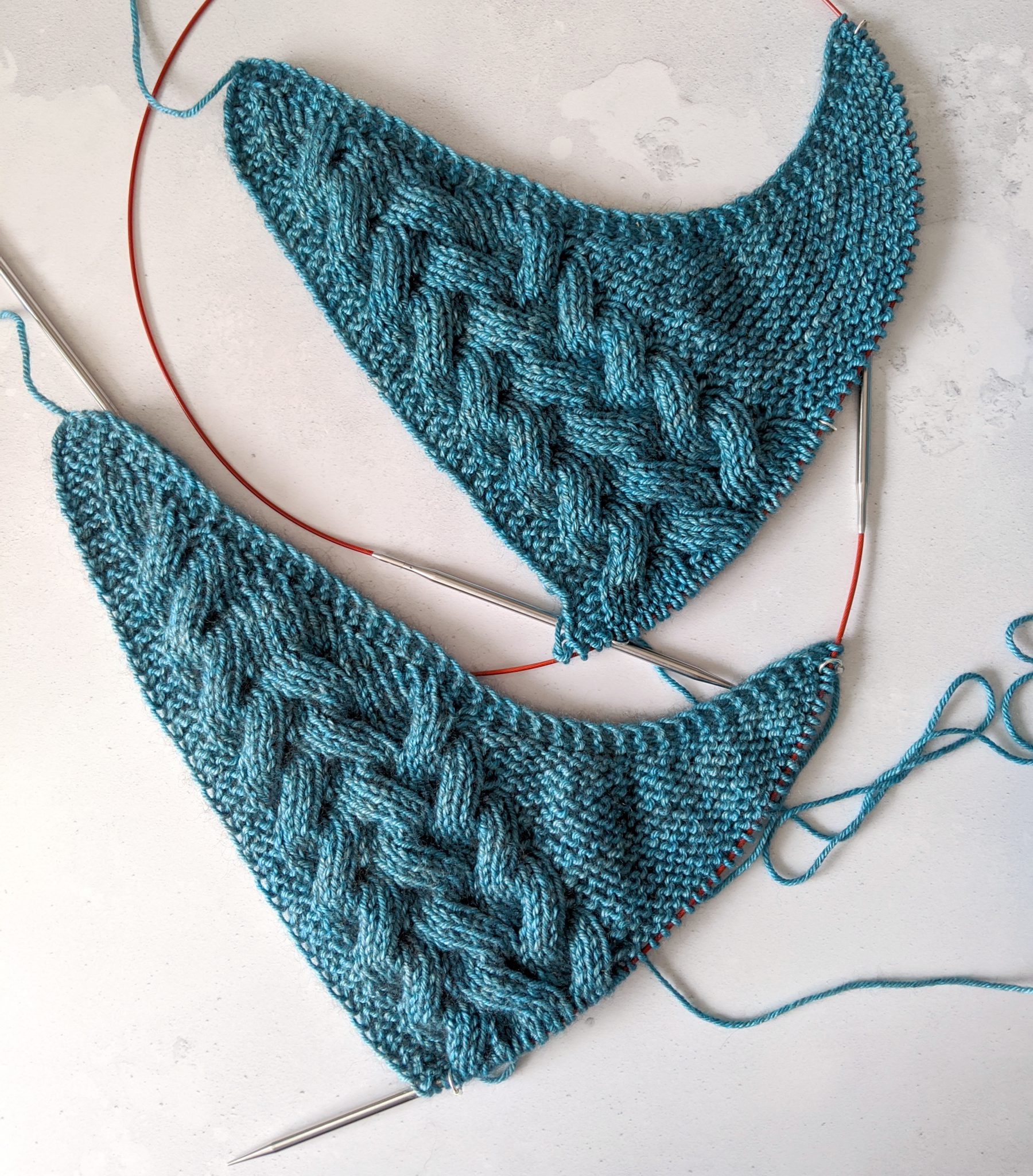 The cabled set up section of the same shawl with slightly different lengths