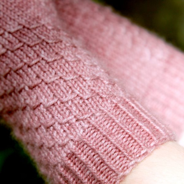 A close up of the textured pattern and the cuff