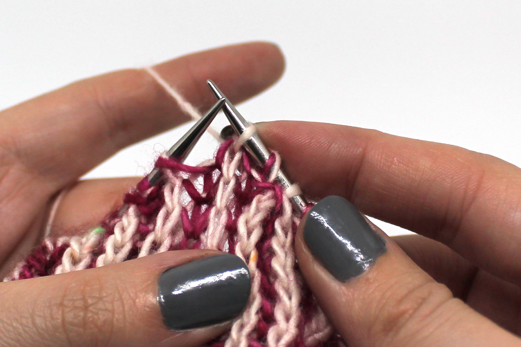 The first two stitches on the right hand needle have been knitted together through the back loop.