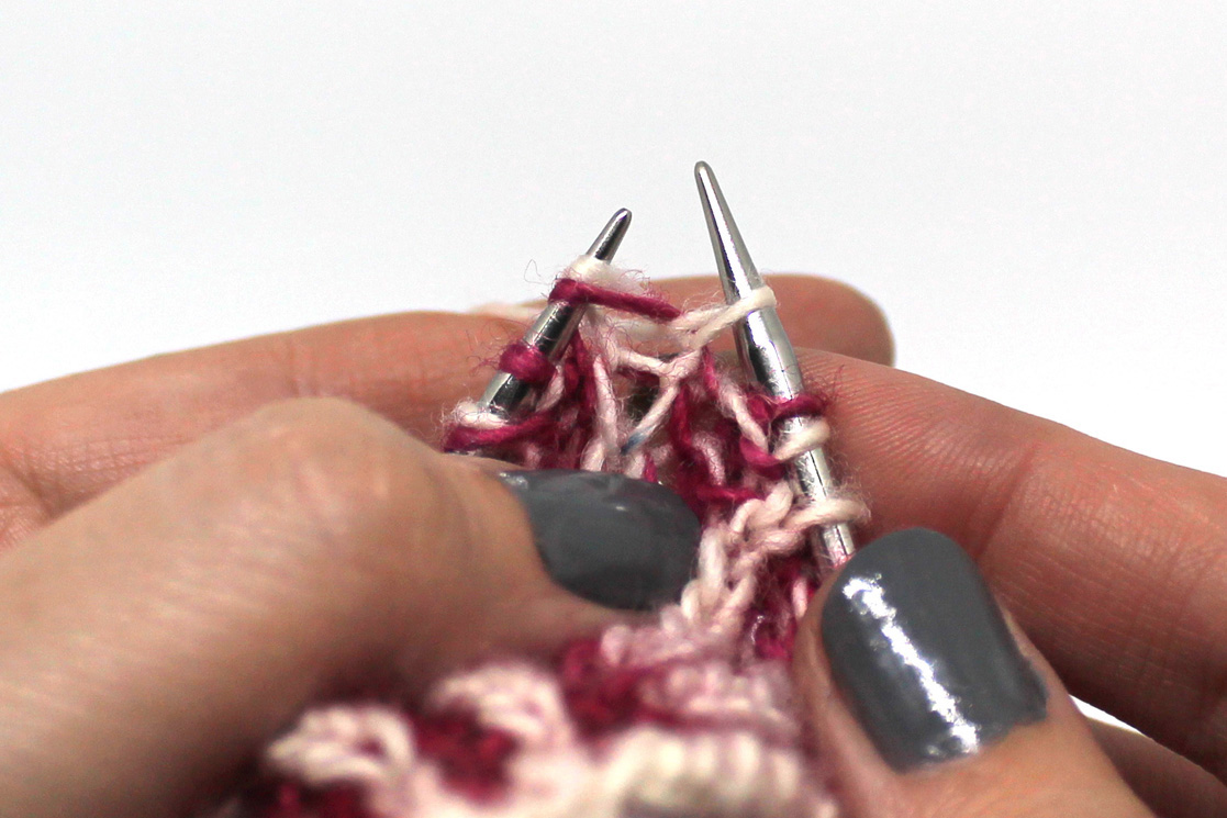 A knit stitch through the first stitch on the left hand needle. The stitch remains on the left hand needle