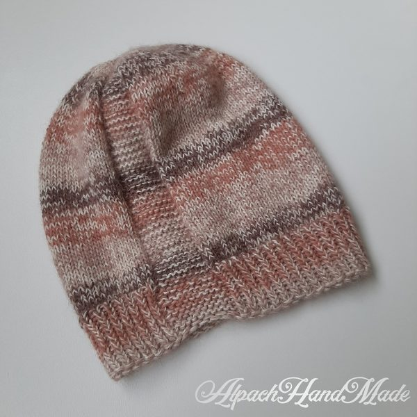 A hat knit with stripes in shades of brown and two garter stitch columns laid flat