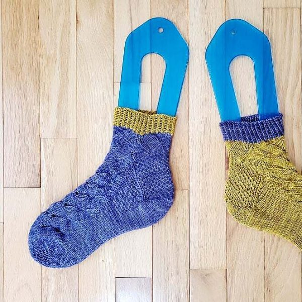 Karen knit her small socks in The Plucky Knitter Plucky Feet in Starlings and SockObsession Yarns Reliant Smooth Sock in Lellow Like Moostard