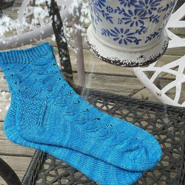Sylvia knit her medium socks in Malabrigo Sock in Cote D' Azure