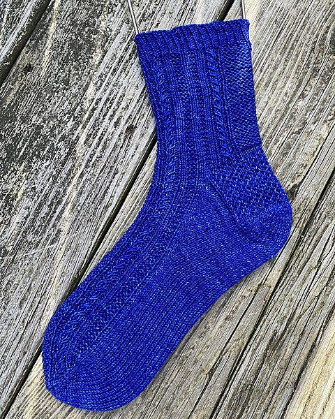 Christine knit her small Tìorail in Malabrigo Sock in Matisse Blue!